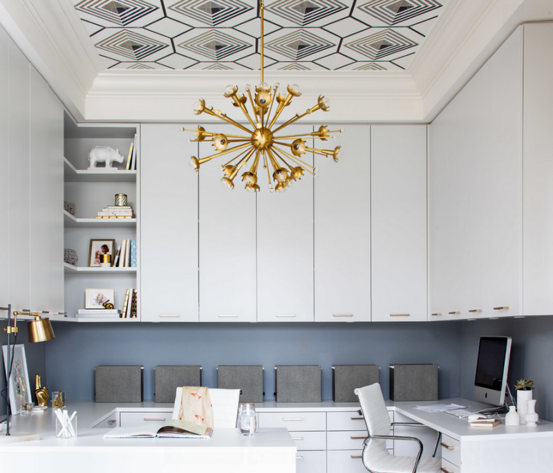 Amazing home office with graphic ceiling and gold accents.