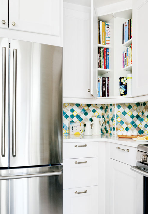 Get smarter about what you store where--cookbooks in a corner kitchen cabinet.