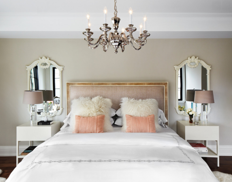 Glamorous bedroom with soft blush hues.