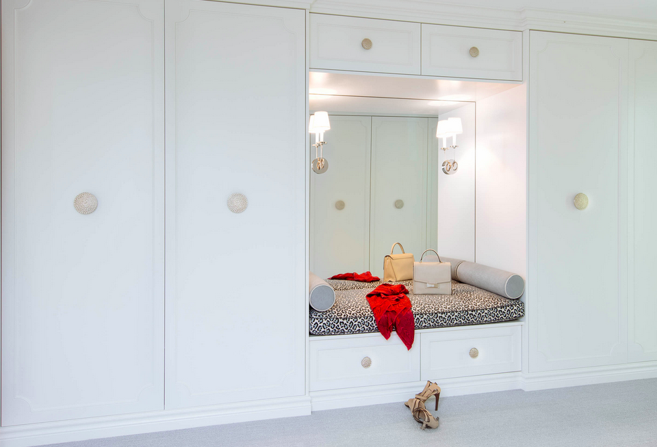 From the work of Meghan Carter Design Inc. --built-in wardrobe with bench and cheetah-print cushion.