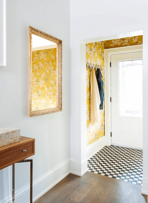 Cheery entryway by Meghan Carter Design Inc. with checkerboard floor.