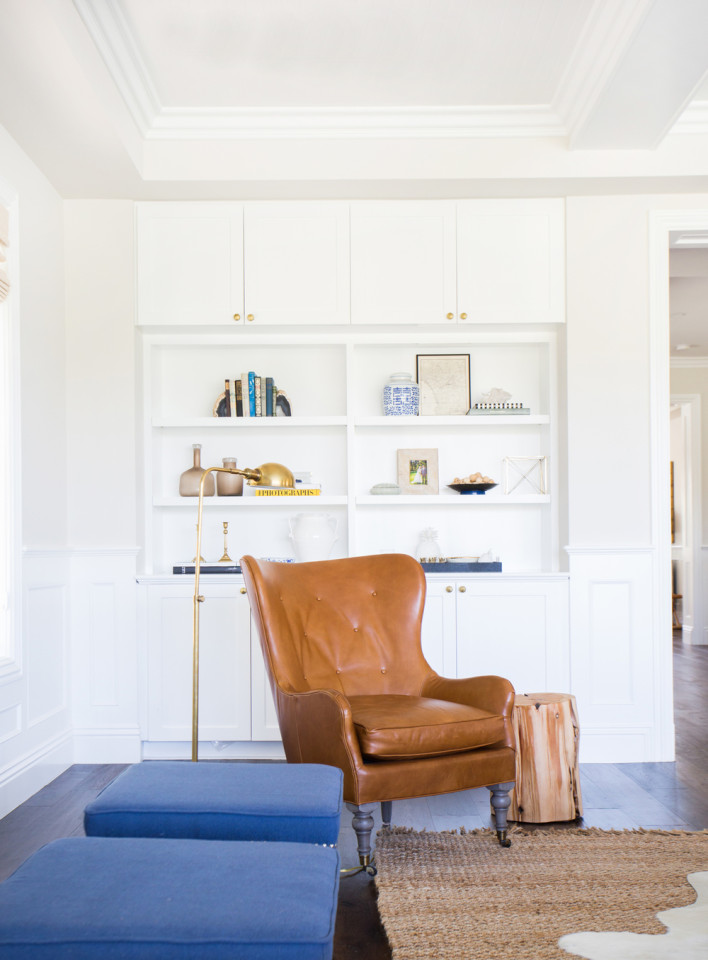 Toffee-leather wingback and beautifully styled bookcase by Studio McGee