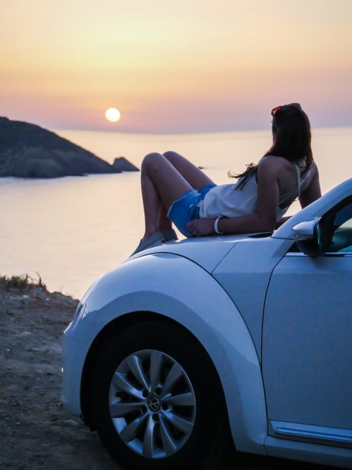 Greek islands at sunset and the custom that surrounds it-- a must-see, must-experience.