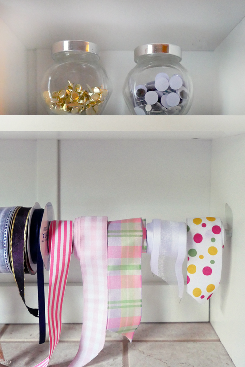 Super simple way to keep gift wrap supplies neat and tidy at all times.