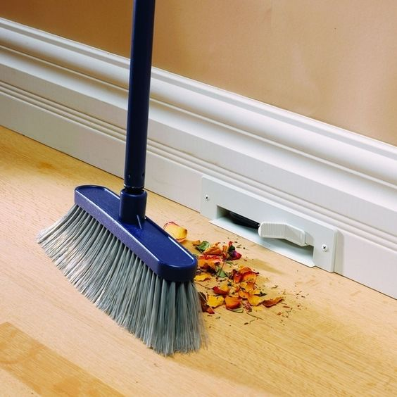 The most genius kitchen design feature...ever??! The toe kick vacuum, also called the automatic dustpan puts crumb disposal right at your feet.
