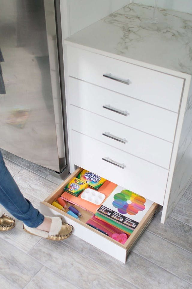 Add to the list of dream kitchen design features: the toe kick drawer.
