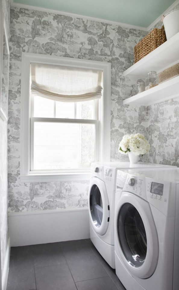 Seriously dreamy laundry room design with beautiful wallpaper and a painted ceiling to boot.