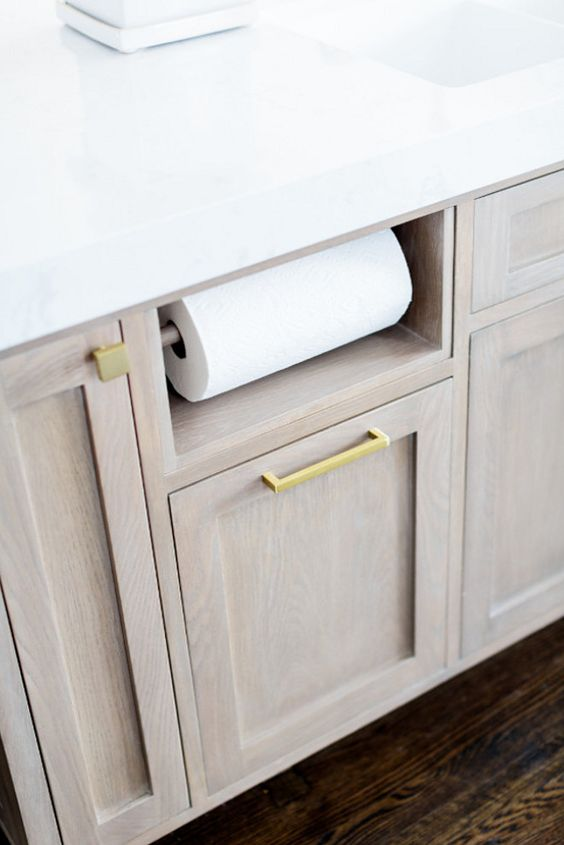 Designing an ideal kitchen? Here's a better way to keep paper towels handy.