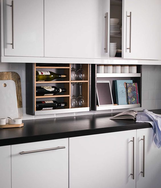 Ingenious kitchen design feature--the hidden pull-down cabinet plus.