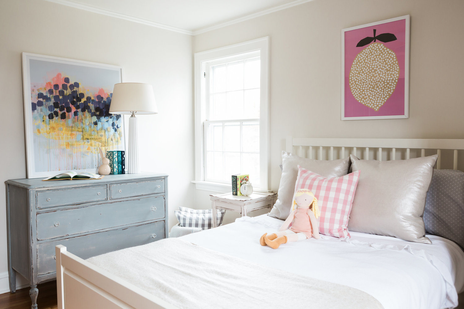 Girl's room with vintage furniture and pink and blue accents.
